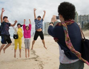 Chinese visitors on Surfers Paradise Beach in Queensland
