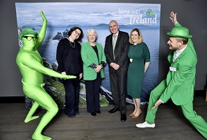 """REPRO FREE 16/03/2018, Copenhagen, Denmark – Minister of State at the Department of Health, Catherine Byrne TD, is visiting Denmark as part of the """"Promote Ireland"""" programme around St Patrick's Day. In Copenhagen, she attended the 'greening' of the Nimb Hotel in Tivoli Gardens and the Radisson Collection Royal Hotel, which re taking part in Tourism Ireland's annual Global Greening 2018. PIC SHOWS: Minister Catherine Byrne (third left) in Copenhagen with St Patrick's characters; Cliona Manahan, Ambassador of Ireland to Denmark; Peter Nash and Julie McLaughlin, both Tourism Ireland.  Pic – KHAN TARIQ MIKKEL (no repro fee) Further press info – Sinéad Grace, Tourism Ireland 087 685 9027"""
