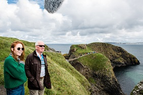 Angela Scanlon and her dad, Phelim, pictured at Carrick-a-Rede rope bridge during filming for a new online video to promote driving holidays around Northern Ireland during the autumn. Pic by Elaine Hill Photography (repro free)   Further media information: Elaine Moore / Clair Balmer, Tourism Ireland Tel: 077 6652 7719
